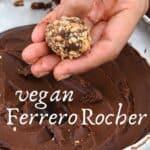 Hand holding a Ferrero Rocher truffle