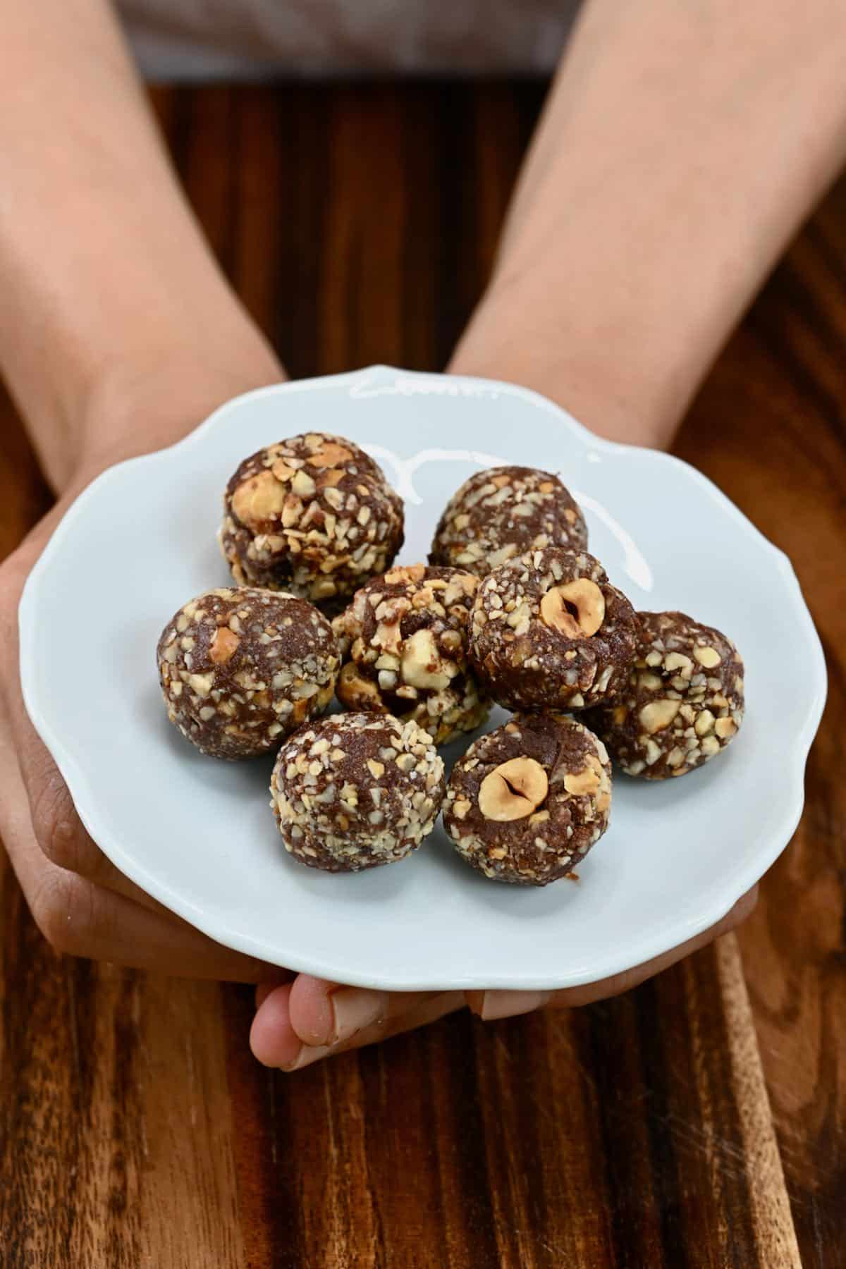 Holding a plate with vegan Ferrero Rocher