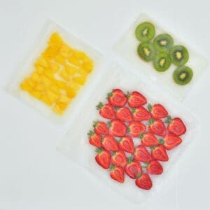 Three freezer bags filled with fruit slices