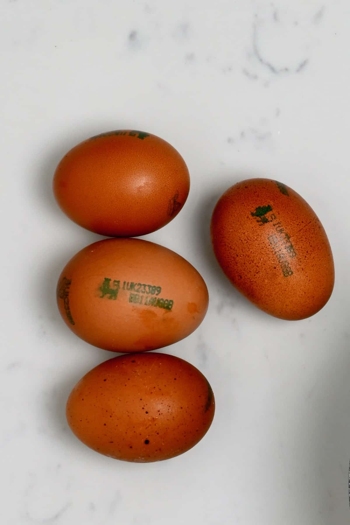 Four eggs on a flat surface
