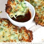 Crispy Vegan Zucchini Fritter in a bowl with dipping sauce