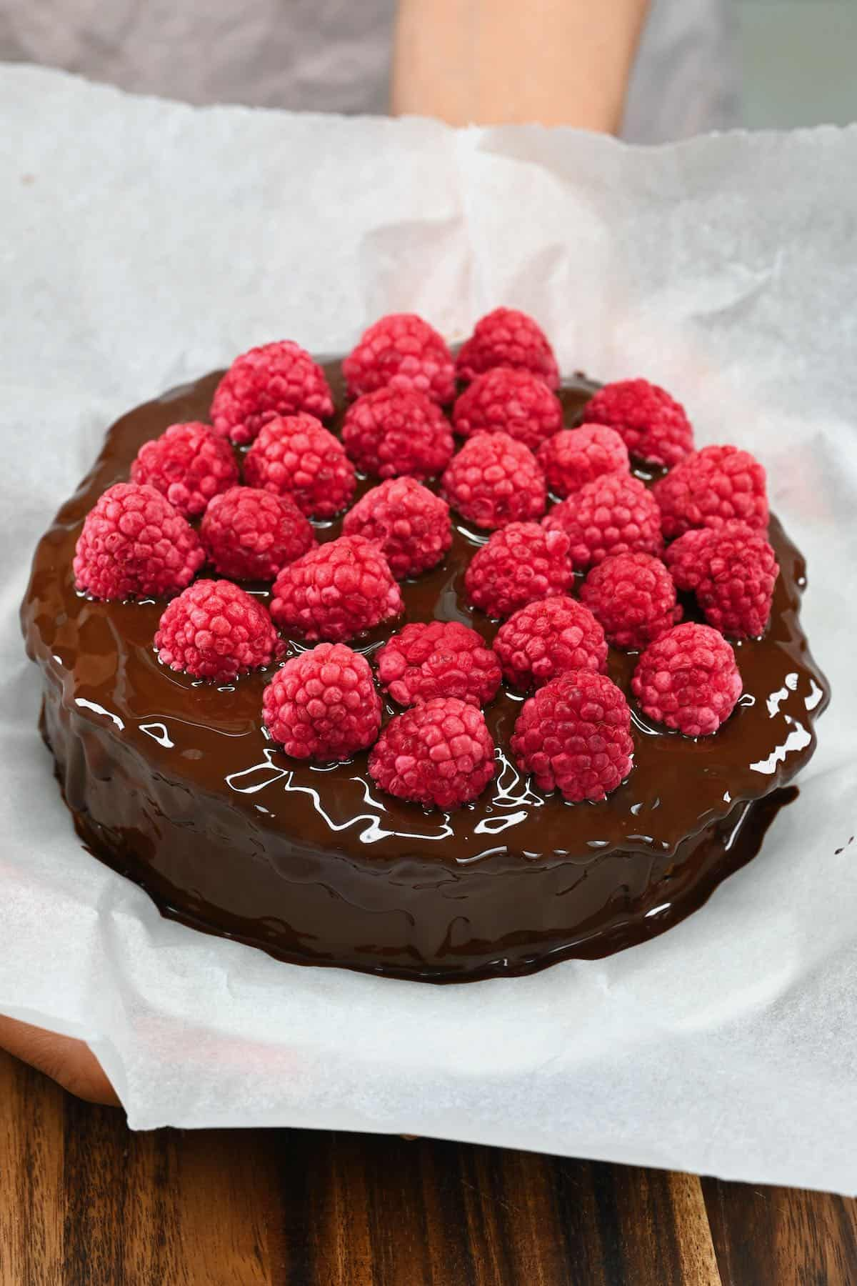 Mars cake with raspberry and chocolate coating