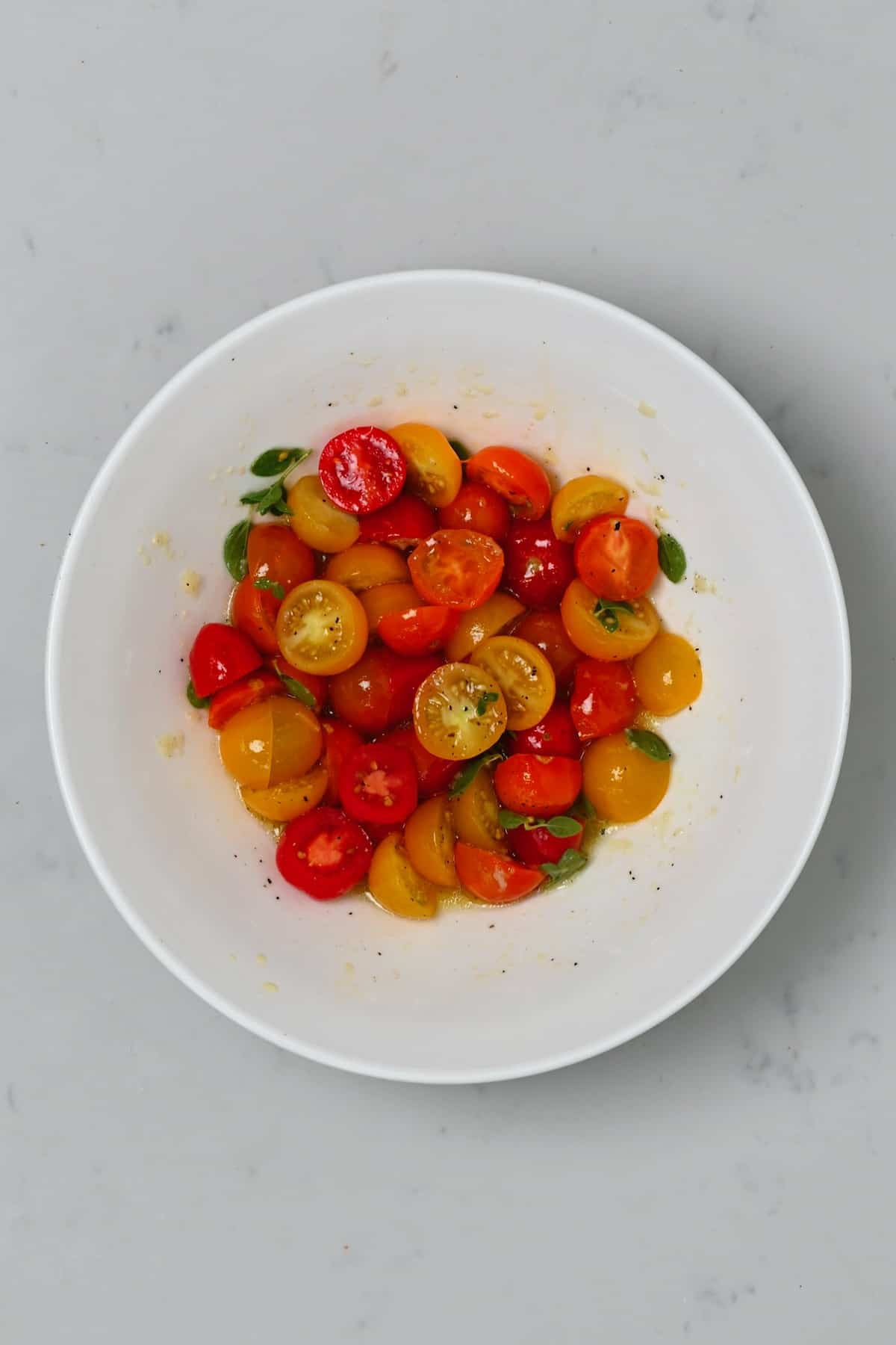 Tomatoes in a bowl with dressing