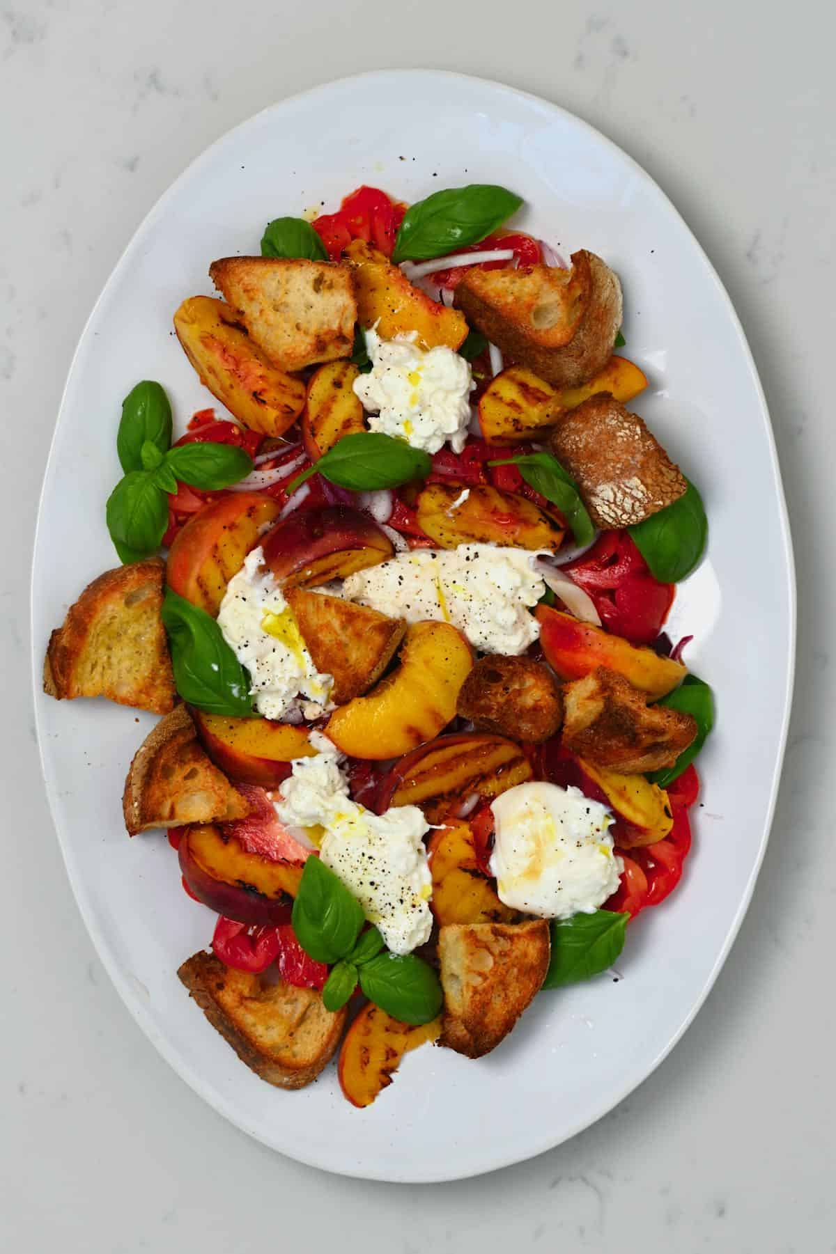 Peach tomato salad on a plate
