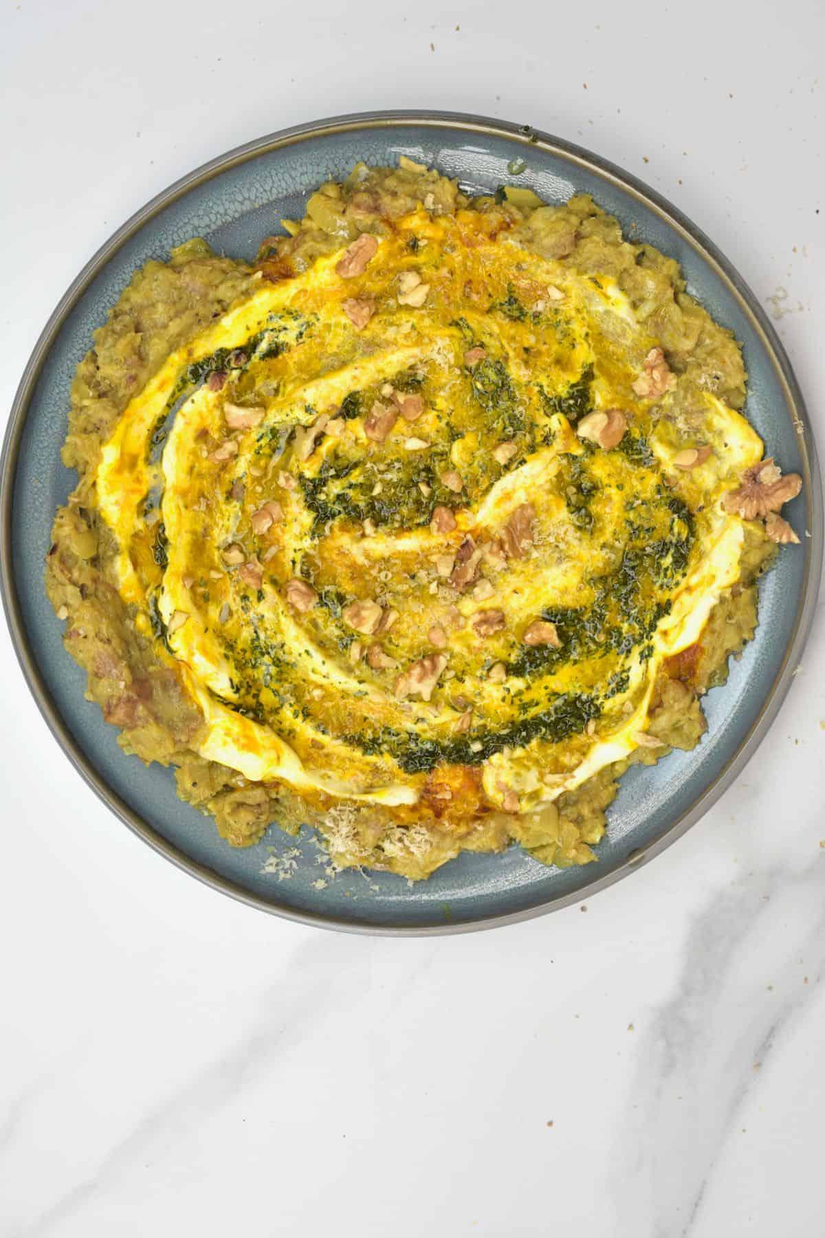 Kashke bademjan served in a plate