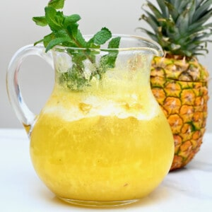 Freshly made pineapple lemonade in a jug