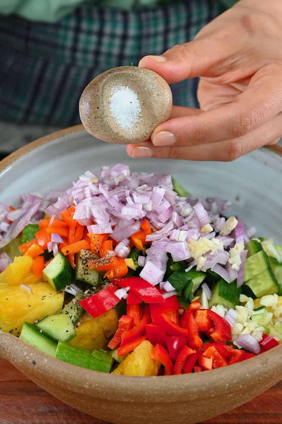 Adding salt to pineapple salad