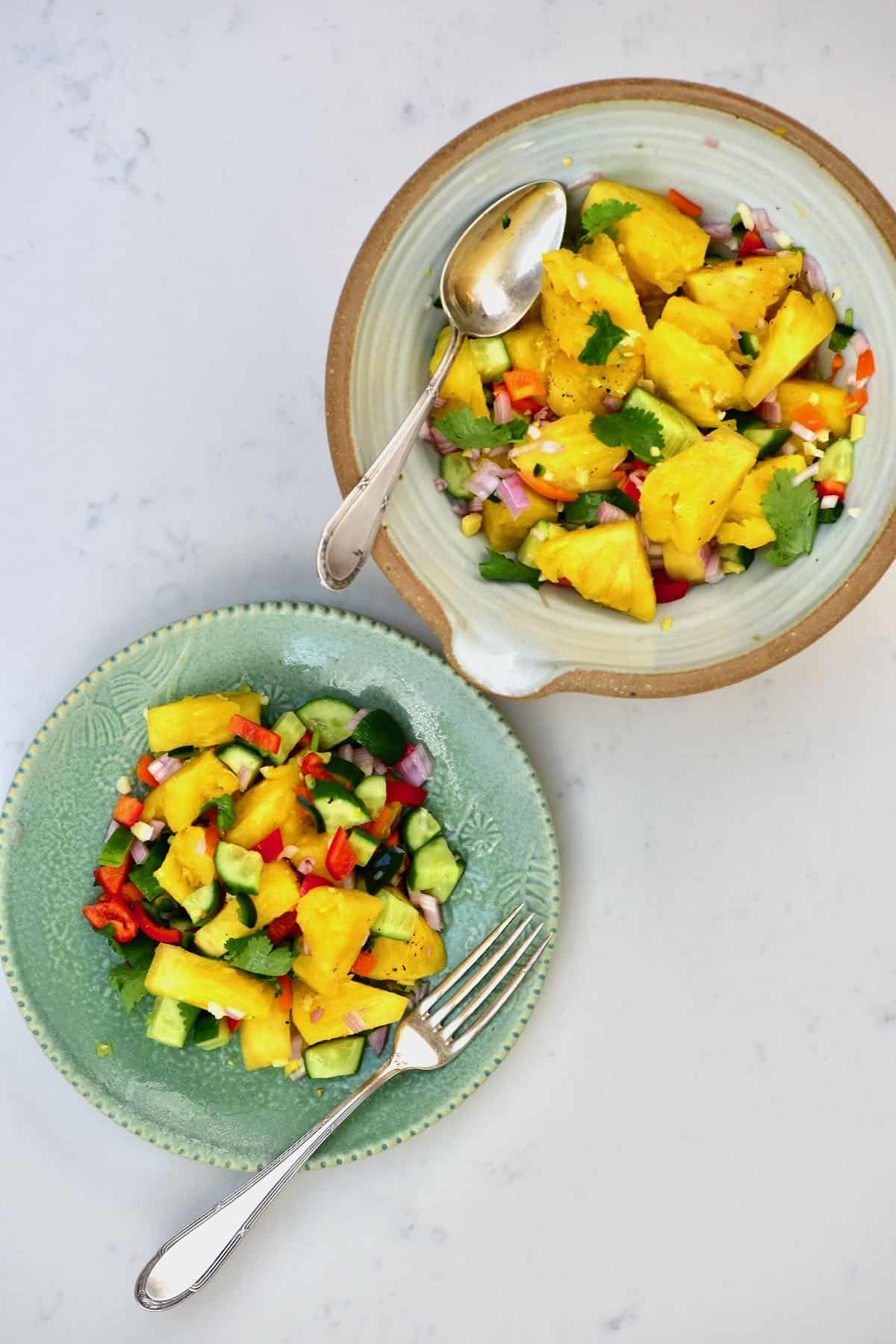 Pineapple salad in a bowl and on a plate