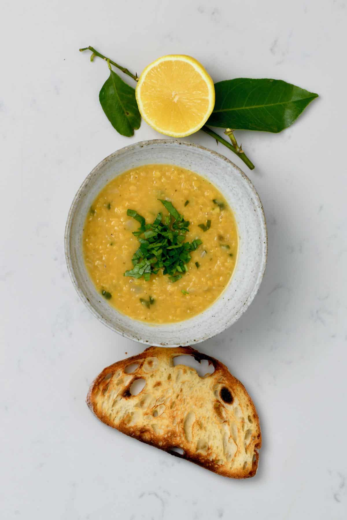 A serving of lentil soup and a piece of bread