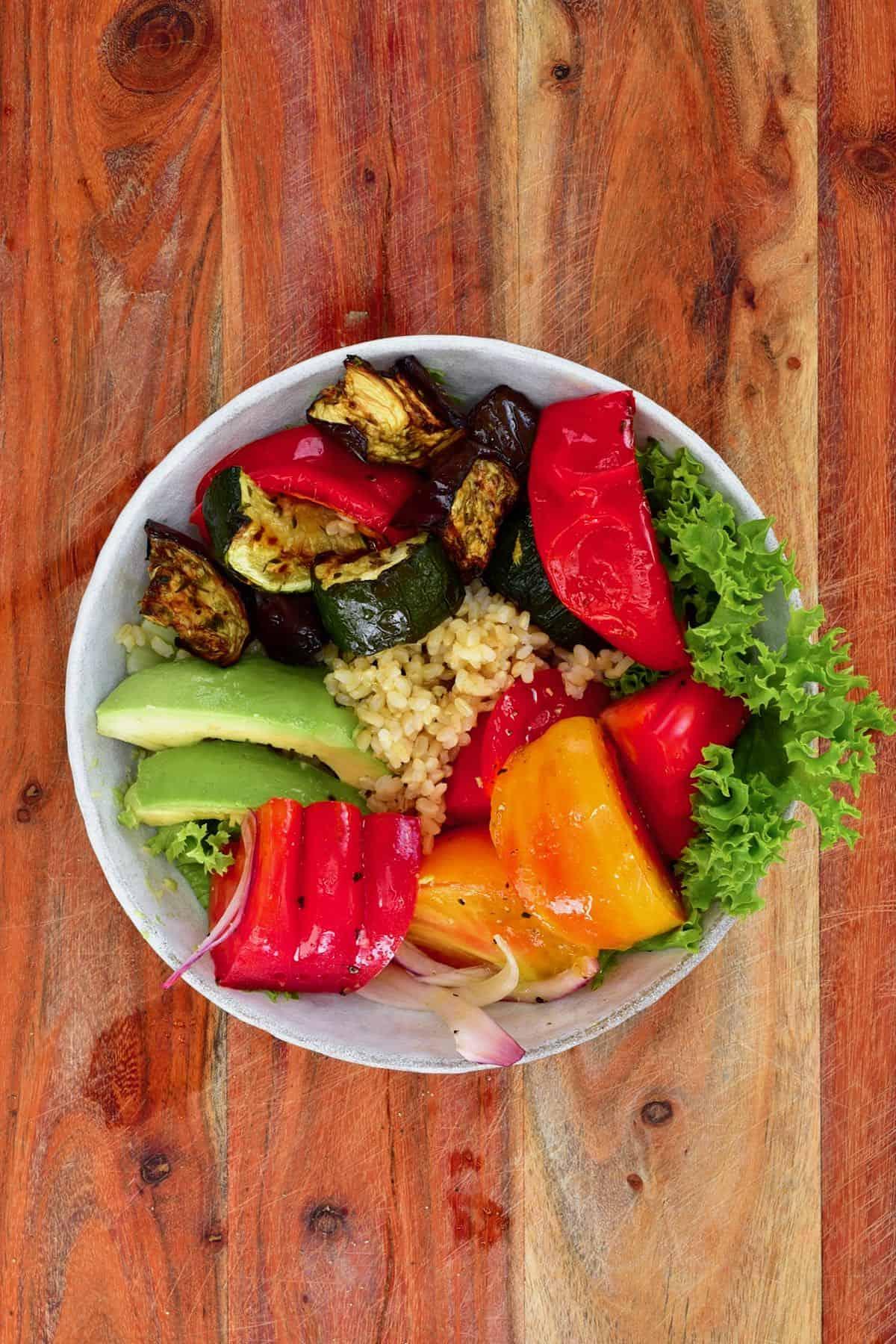 A bowl of roasted veggie salad