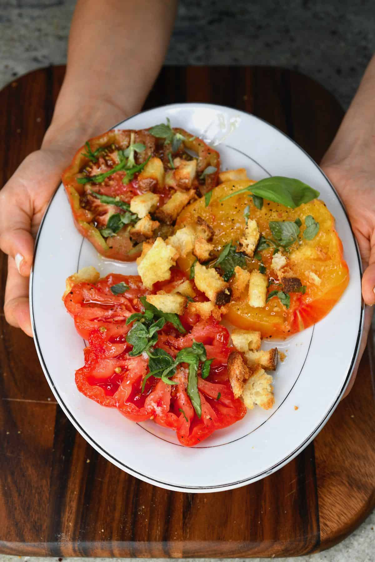 A serving of tomato salad with croutons
