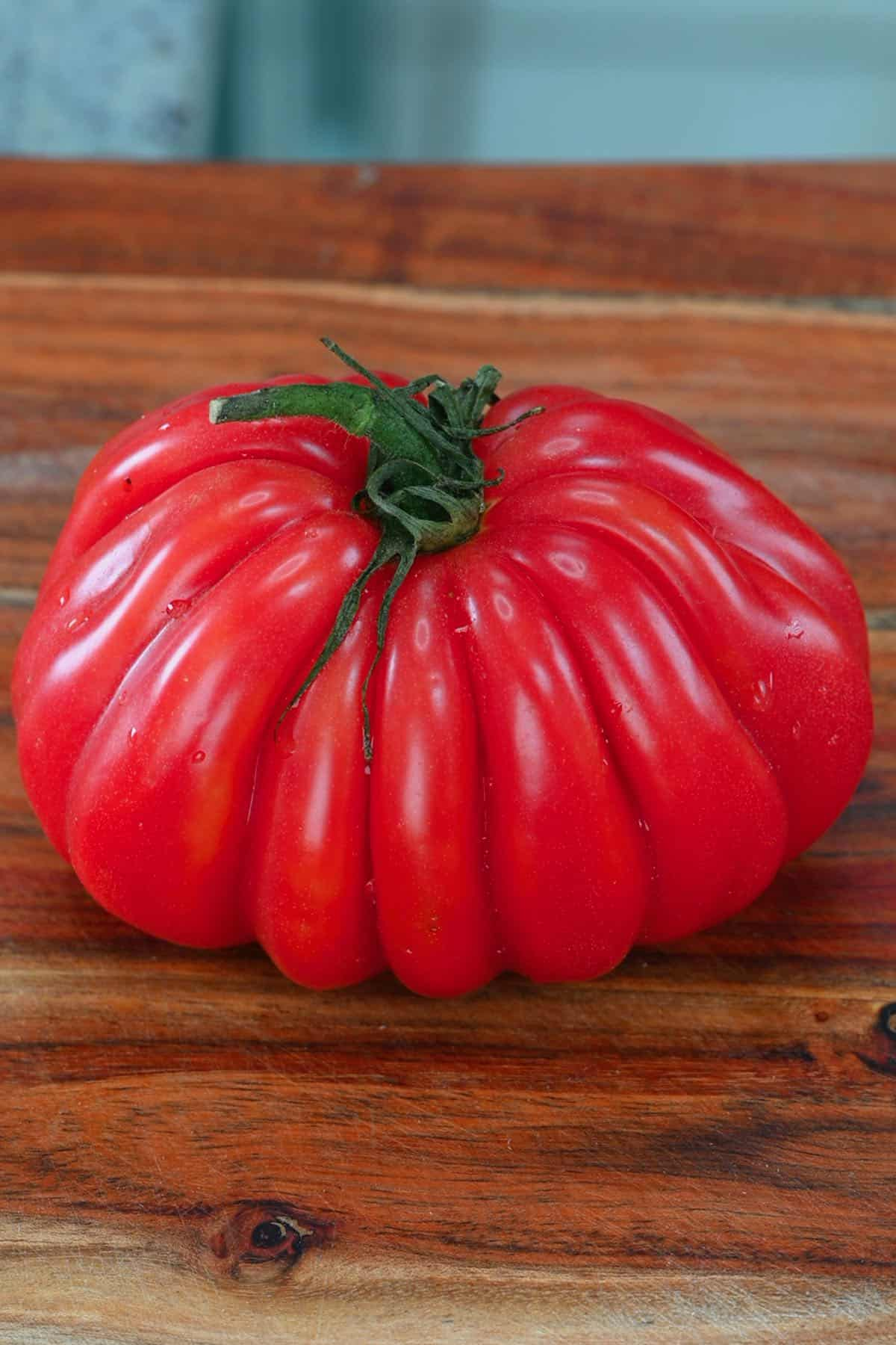 A tomato on a flat surface