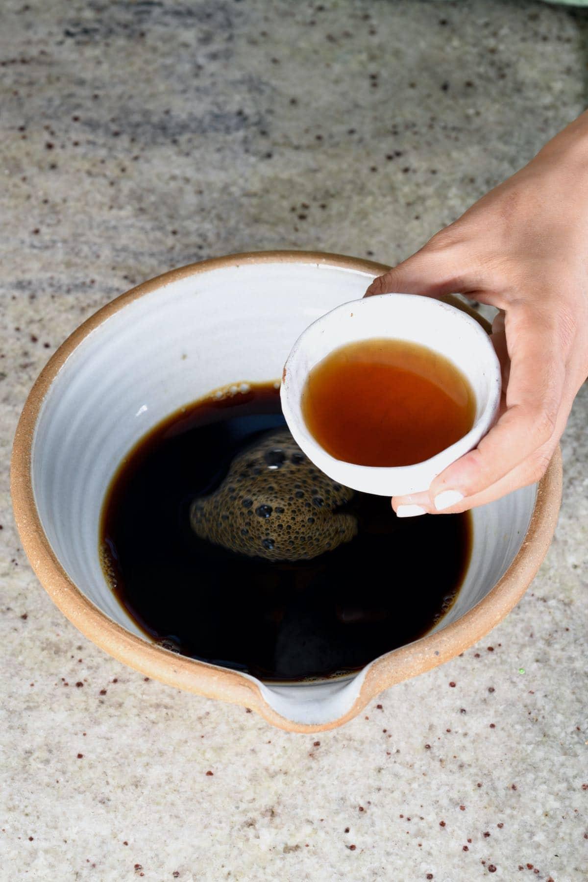 Mixing espresso with marsela