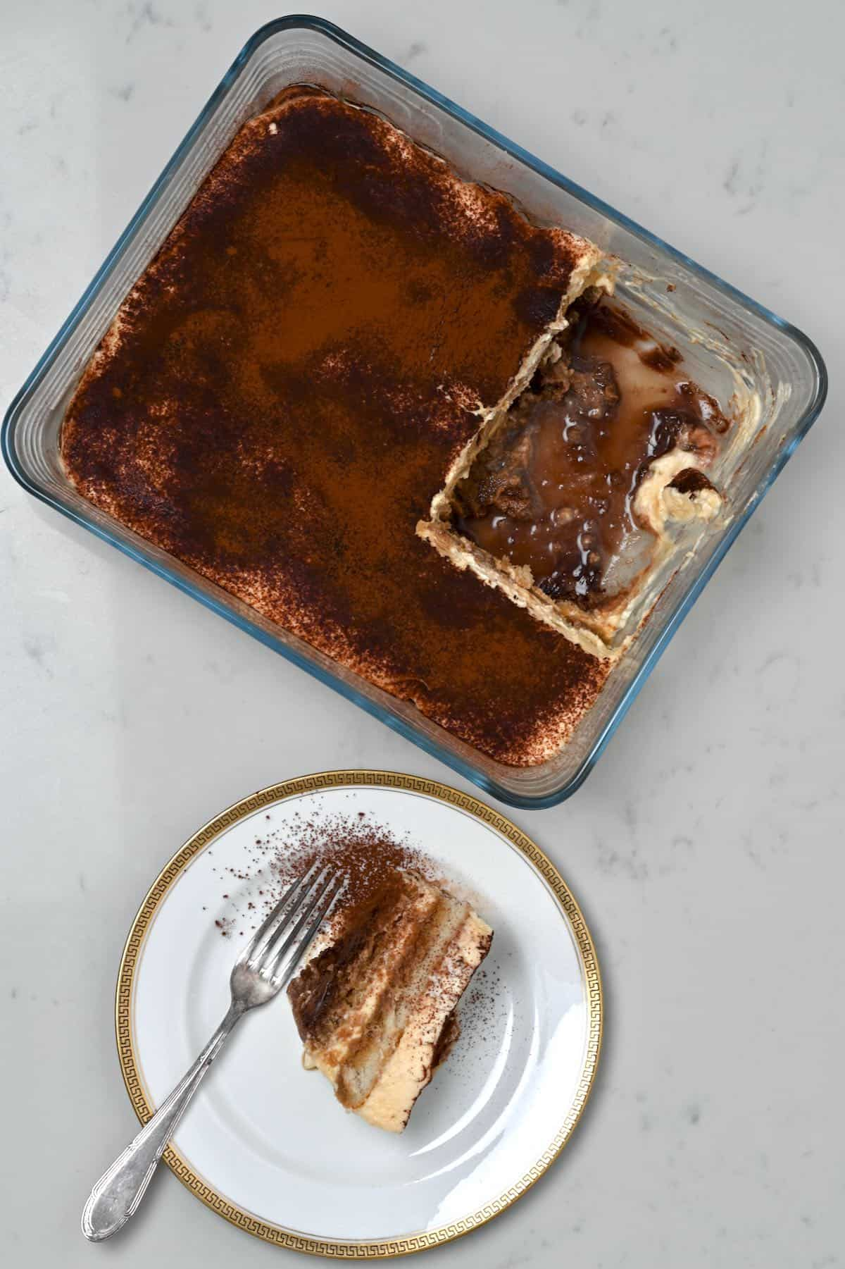 Tiramisu and a serving of it in a plate