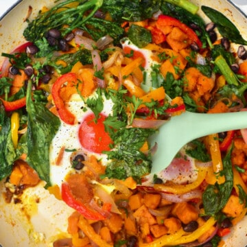 sweet potato hash in a pan with egg