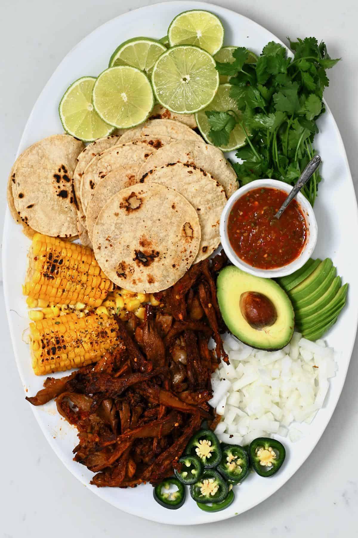 Birria mushroom taco elements on a platter