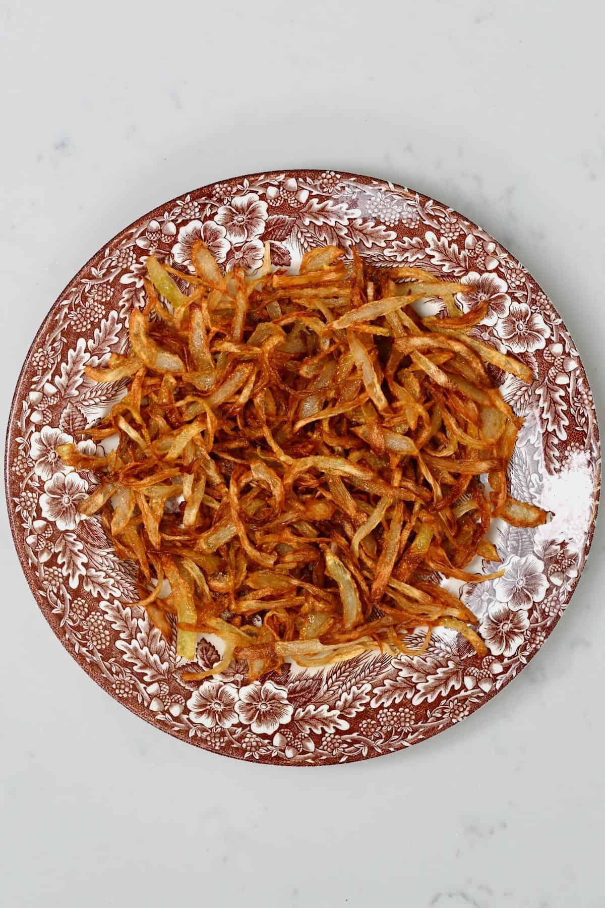 A plate with crispy fried onion