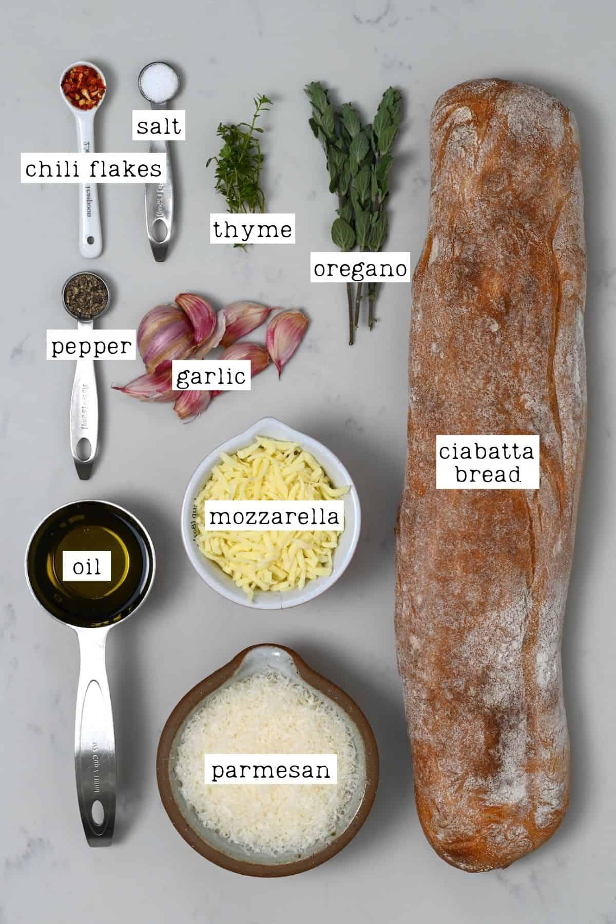 Ingredients for cheesy garlic bread