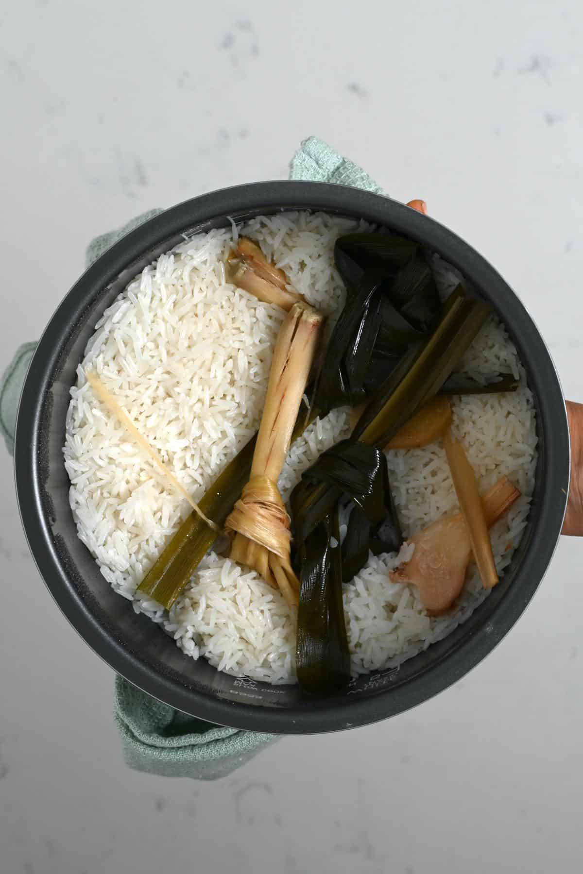 A pot with fragrant rice and lemongrass
