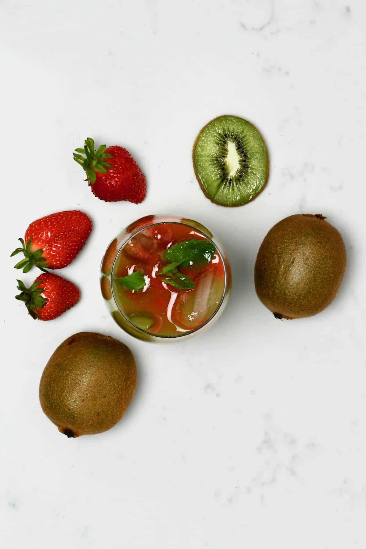 A glass with strawberry kiwi juice