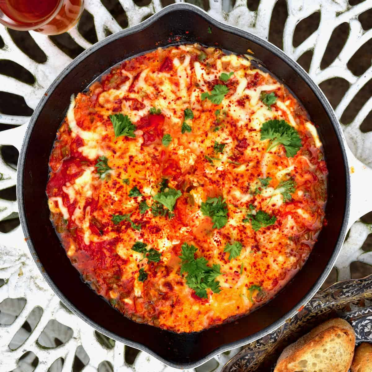 Menemen in a pan with bread and tea
