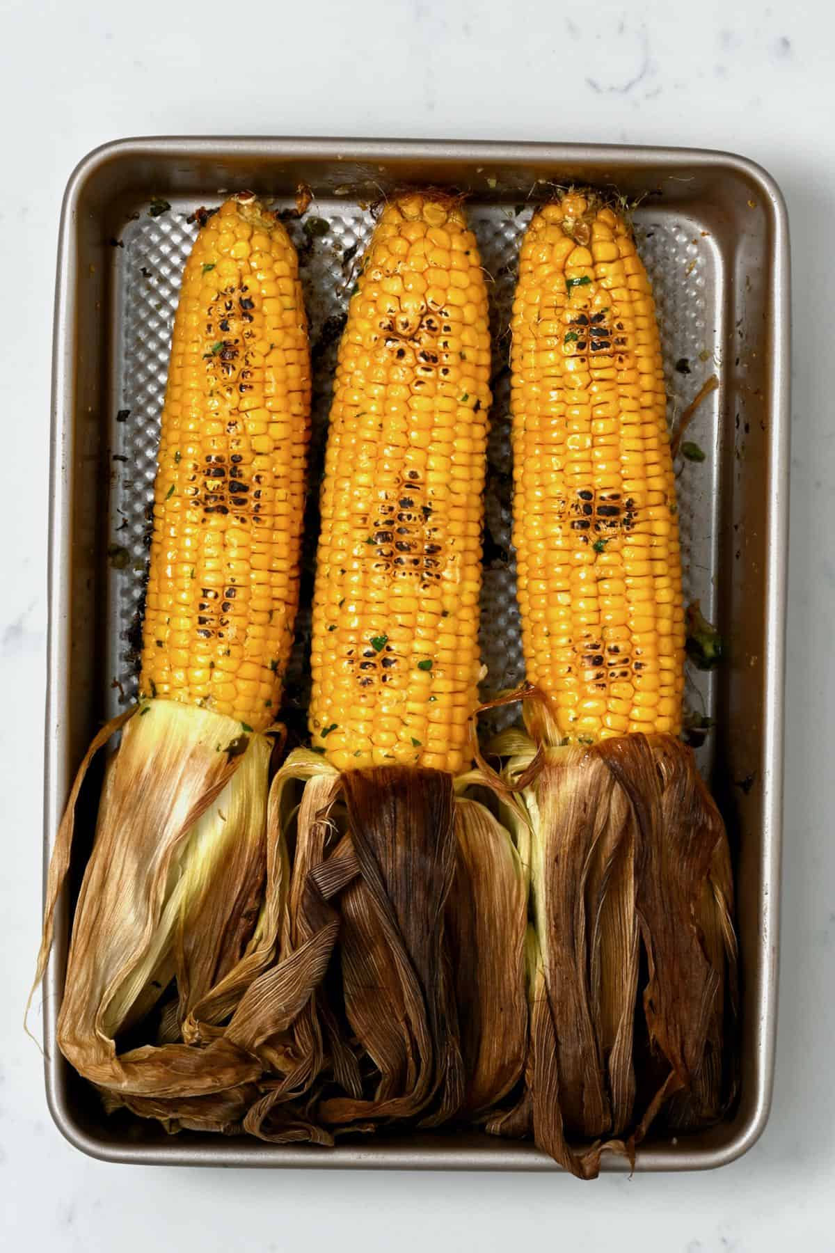 Oven-roasted corn in a tray