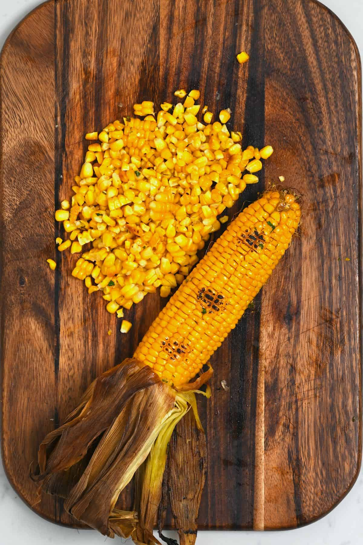 Oven-roasted corn on a cutting board