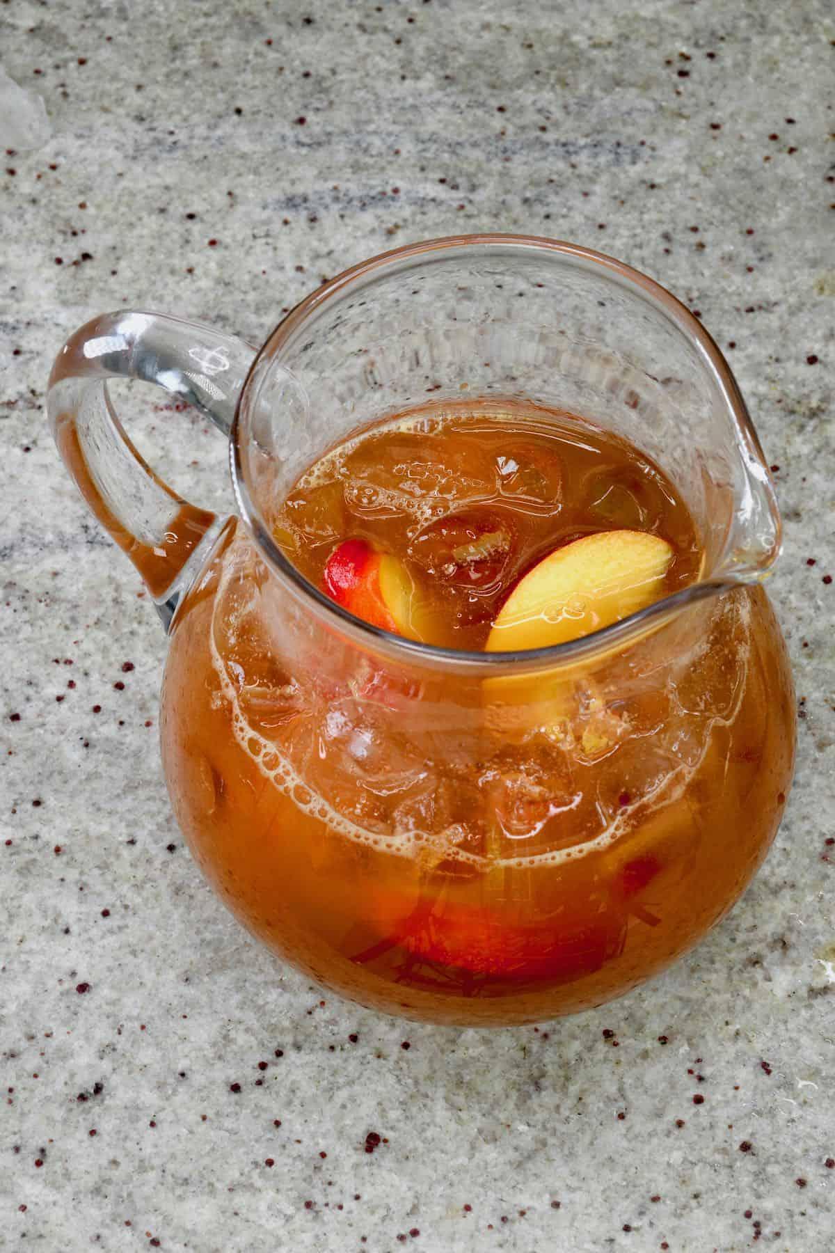 A jug with peach ice tea