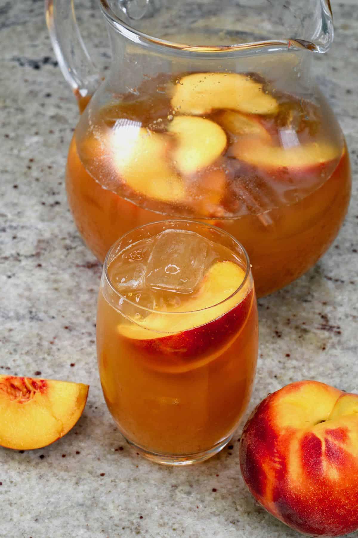 A glass with peach iced tea
