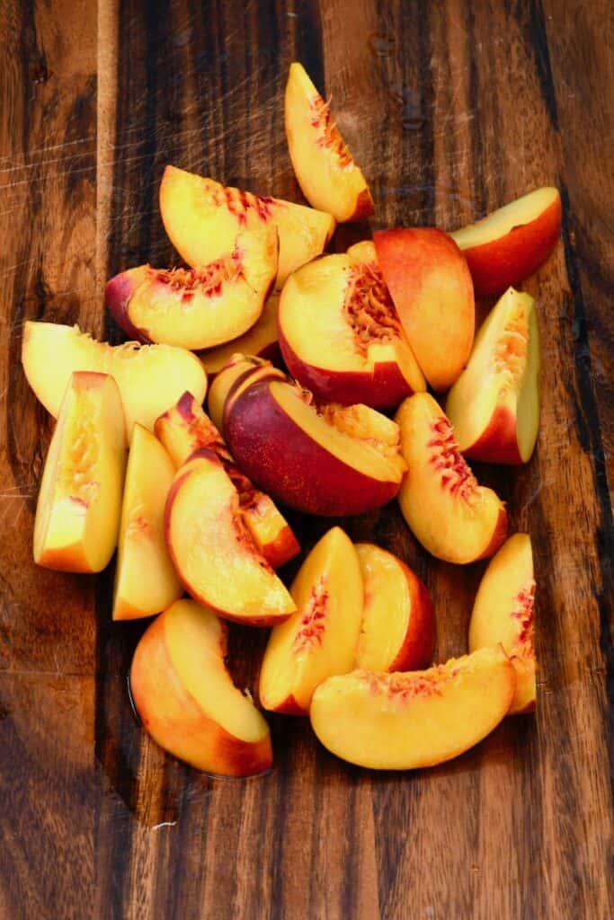 Sliced peaches on a chopping board
