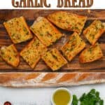 Garlic roasted bread cut into pieces and ingredients to make it