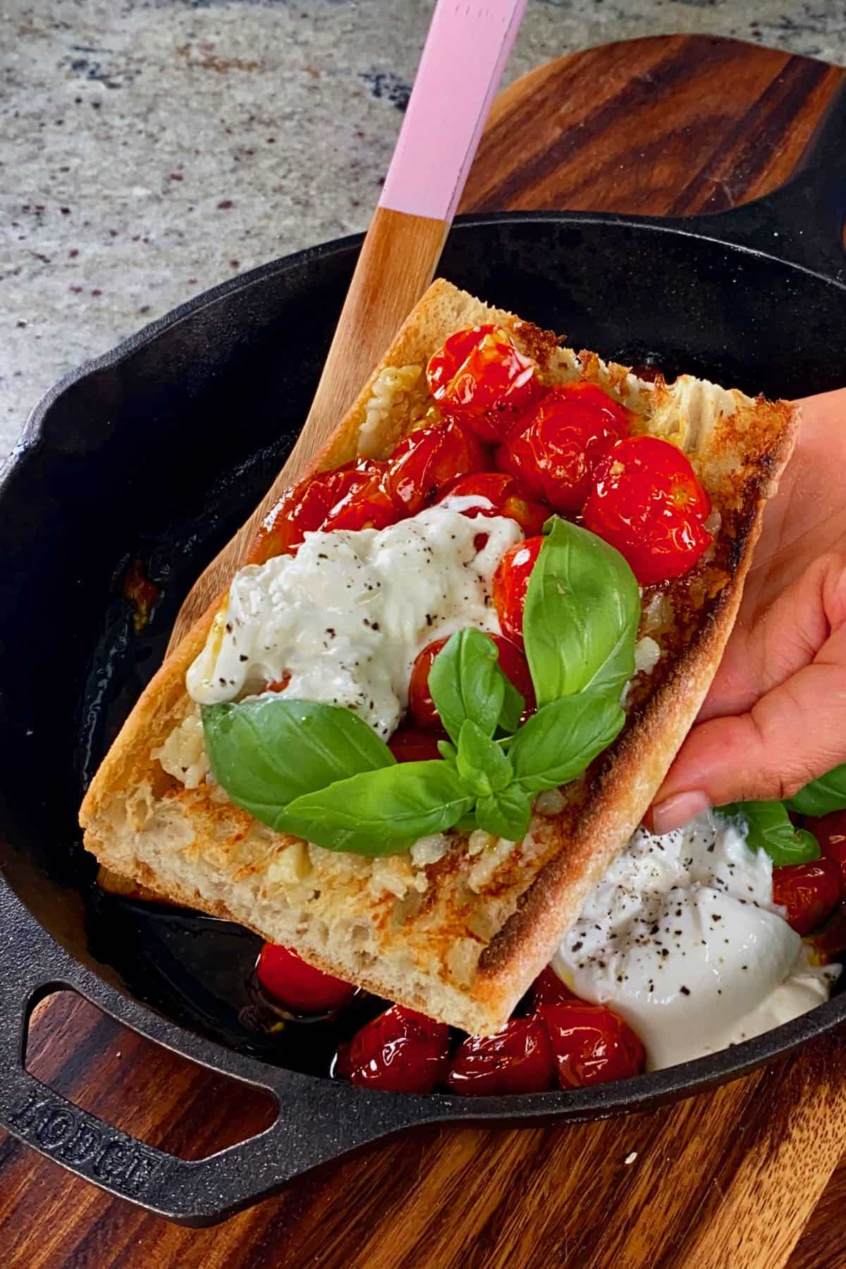 Roasted tomatoes with cheese on a toast