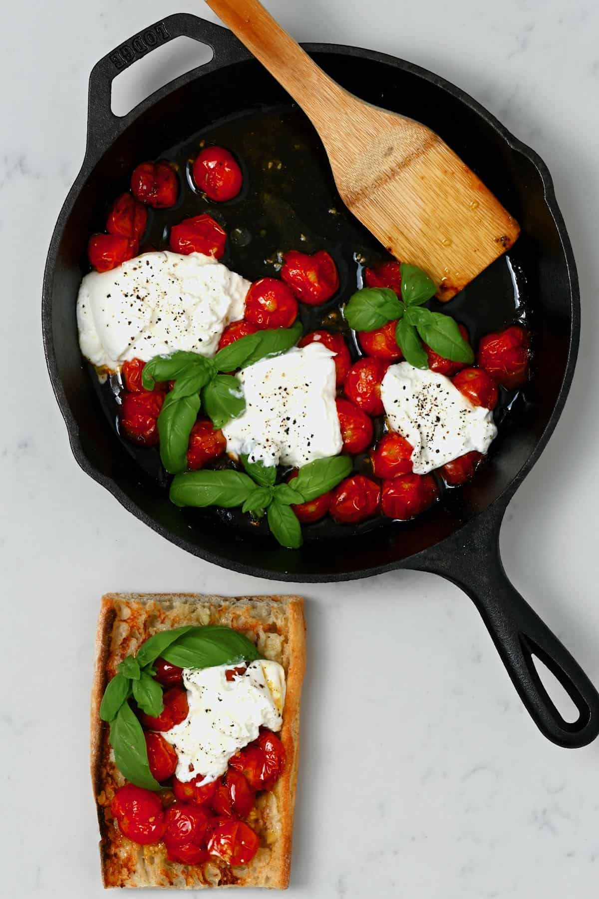 Roasted tomatoes in a pan and on a toast