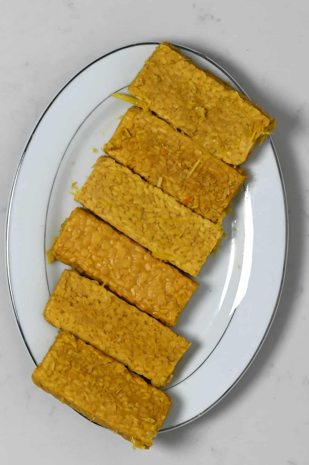 Cooked tempeh on a plate