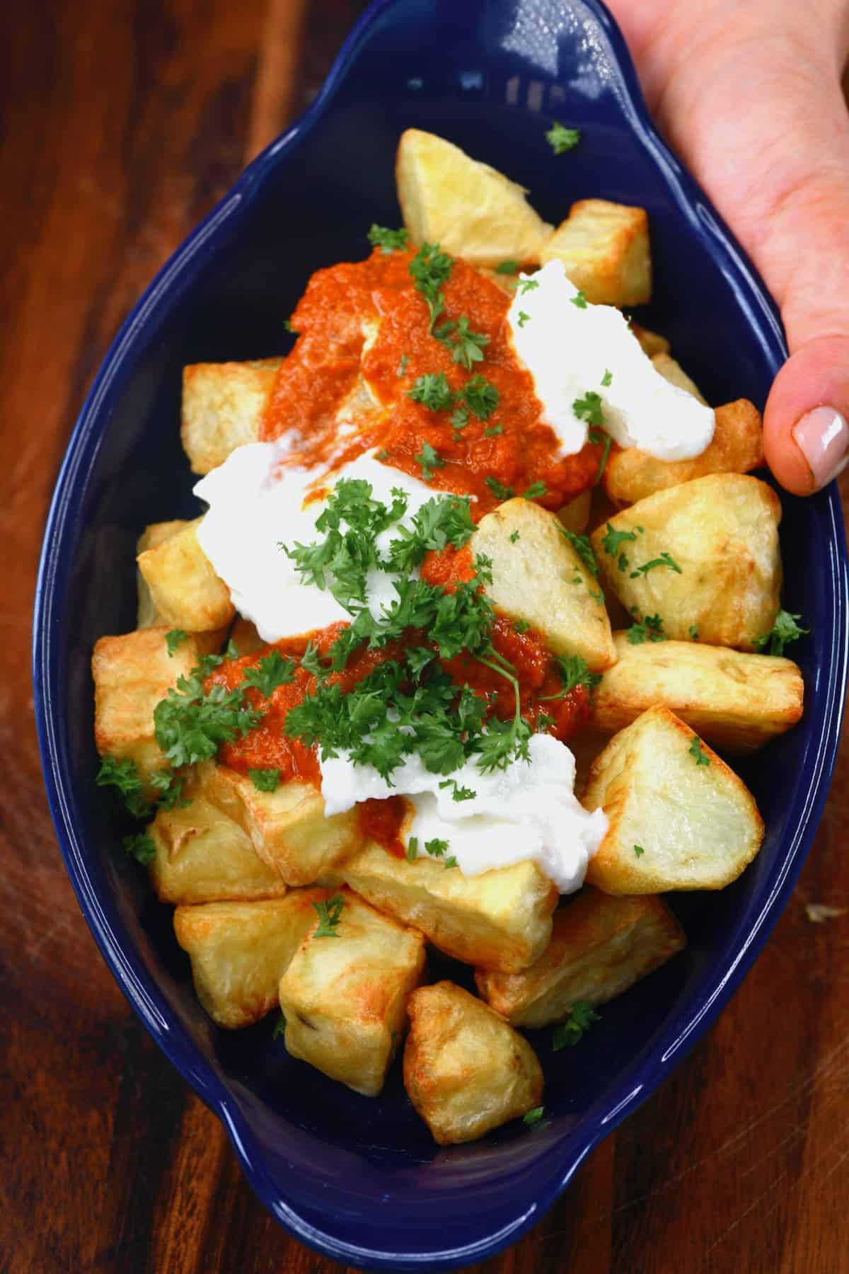 Papatas bravas topped with parsley