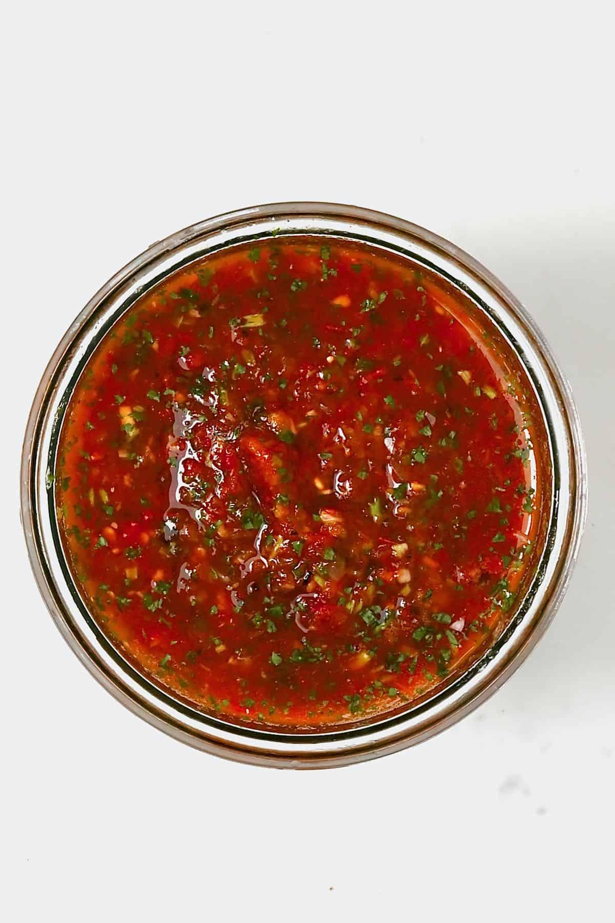 A jar with roasted tomato salsa