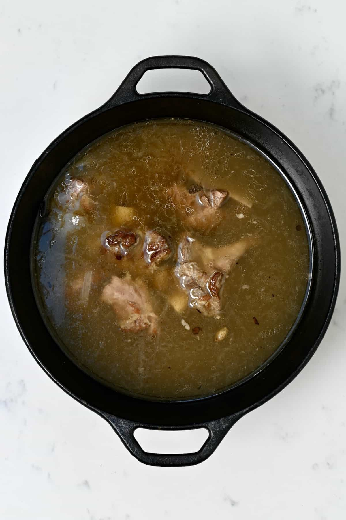 A pot with homemade beef broth