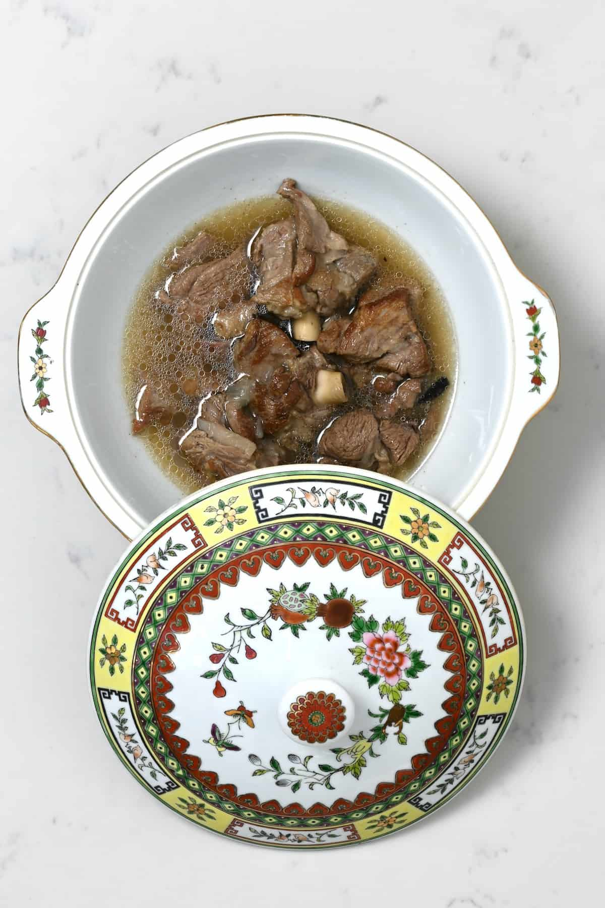 Cooked beed in broth in a bowl
