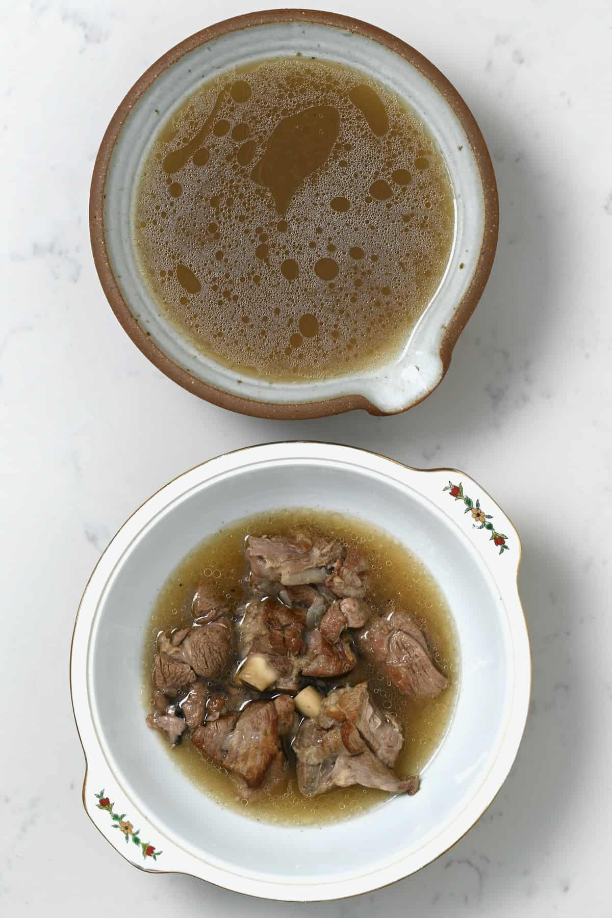 Homemade Beef broth in a bowl and beed ini a pot