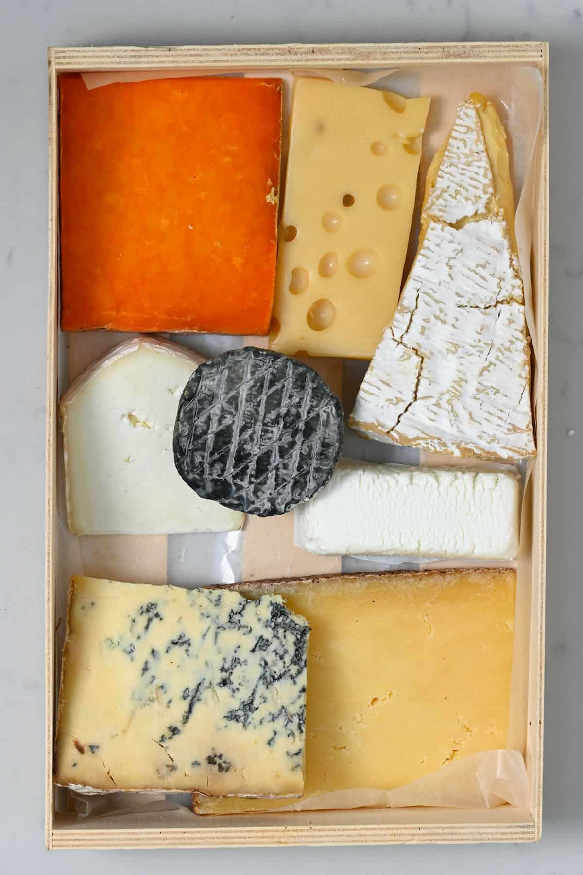 A selection of cheese in a tray