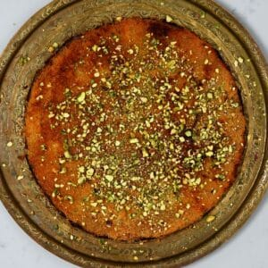 Homemade cheese kunafa topped with pistachios