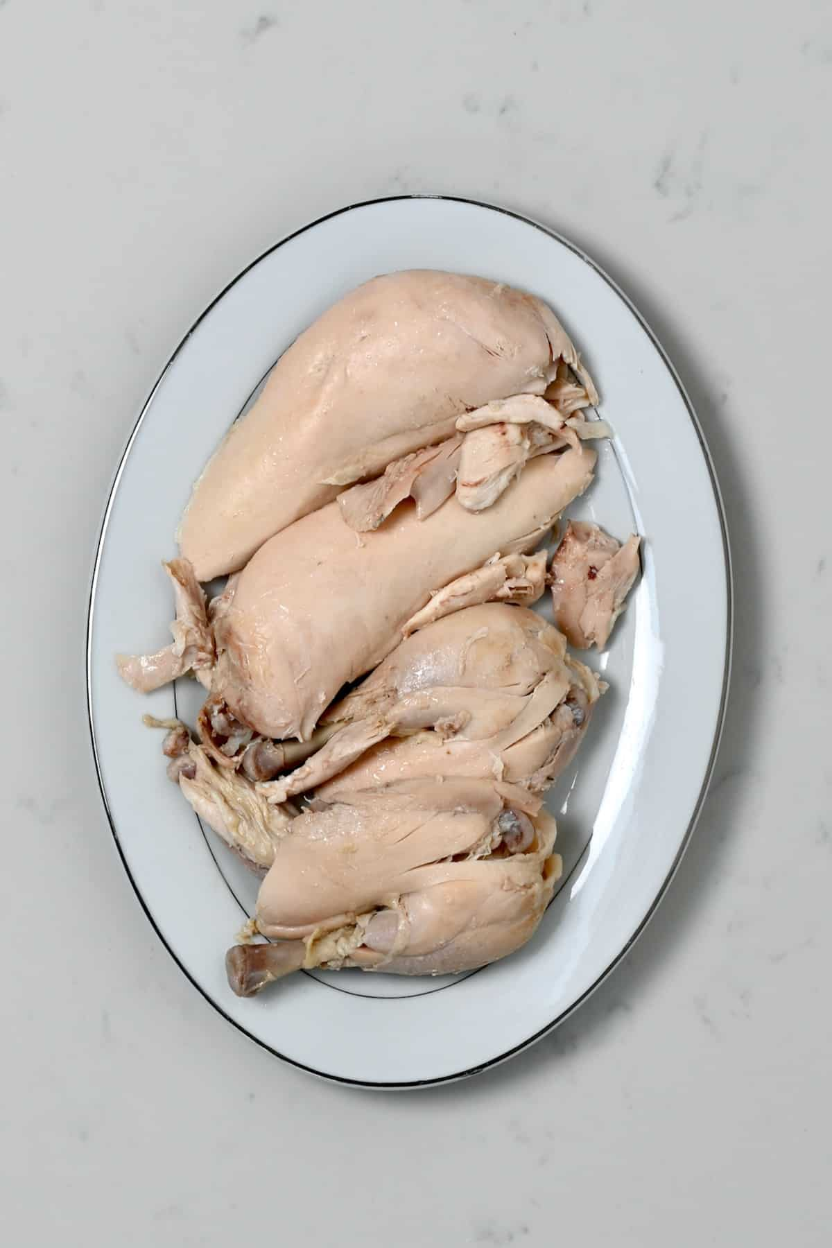 Boiled chicken parts on a plate
