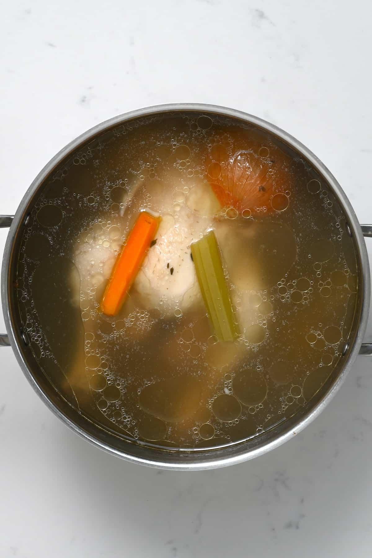 Homemade chicken stock in a pot