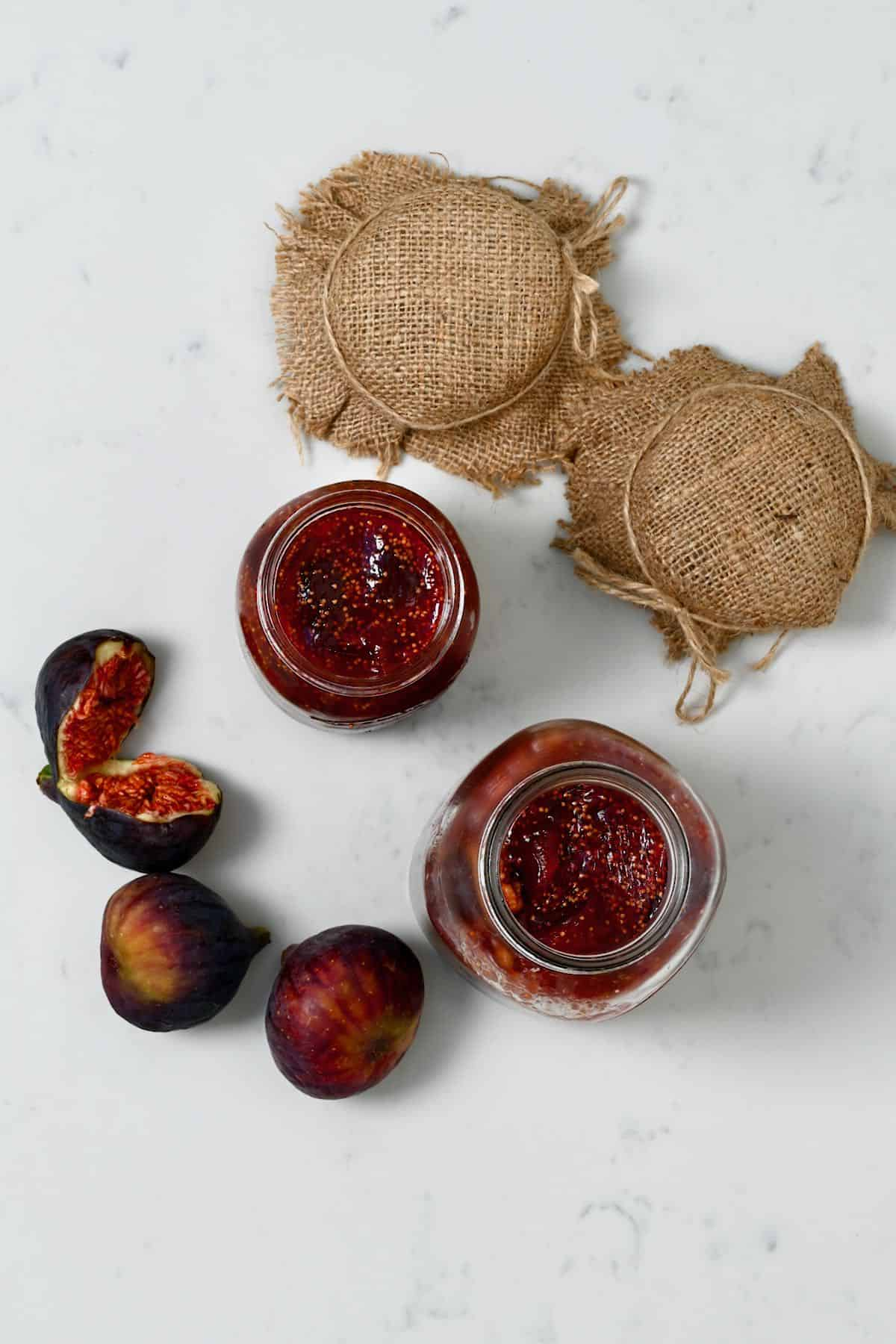 Homemade fig jam in jars and three figs