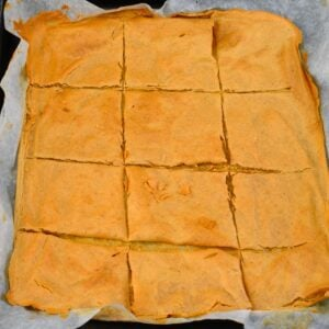 Gluten-Free Red Lentil Crackers (Lentil Chips) on a baking tray with parchment paper
