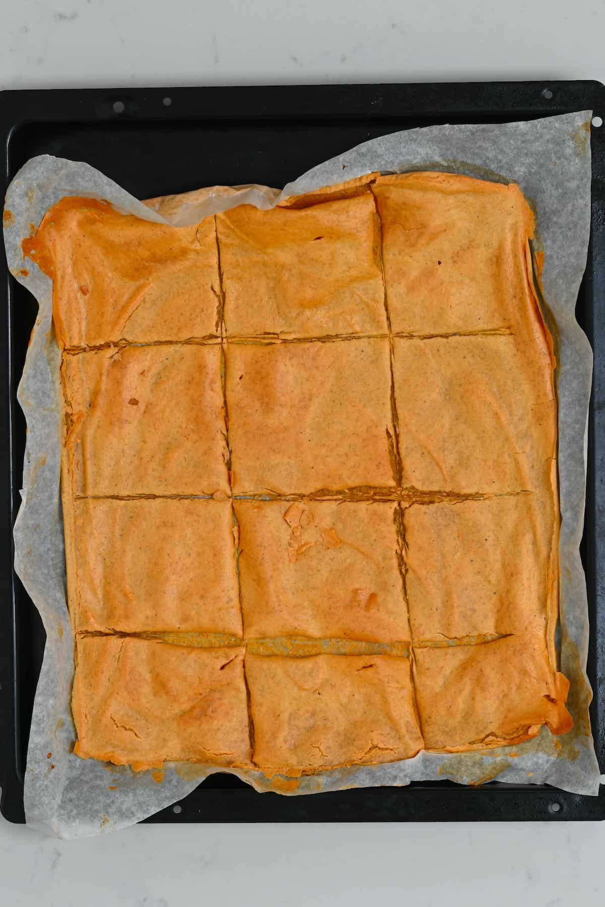 Red lentil crackers on a baking tray