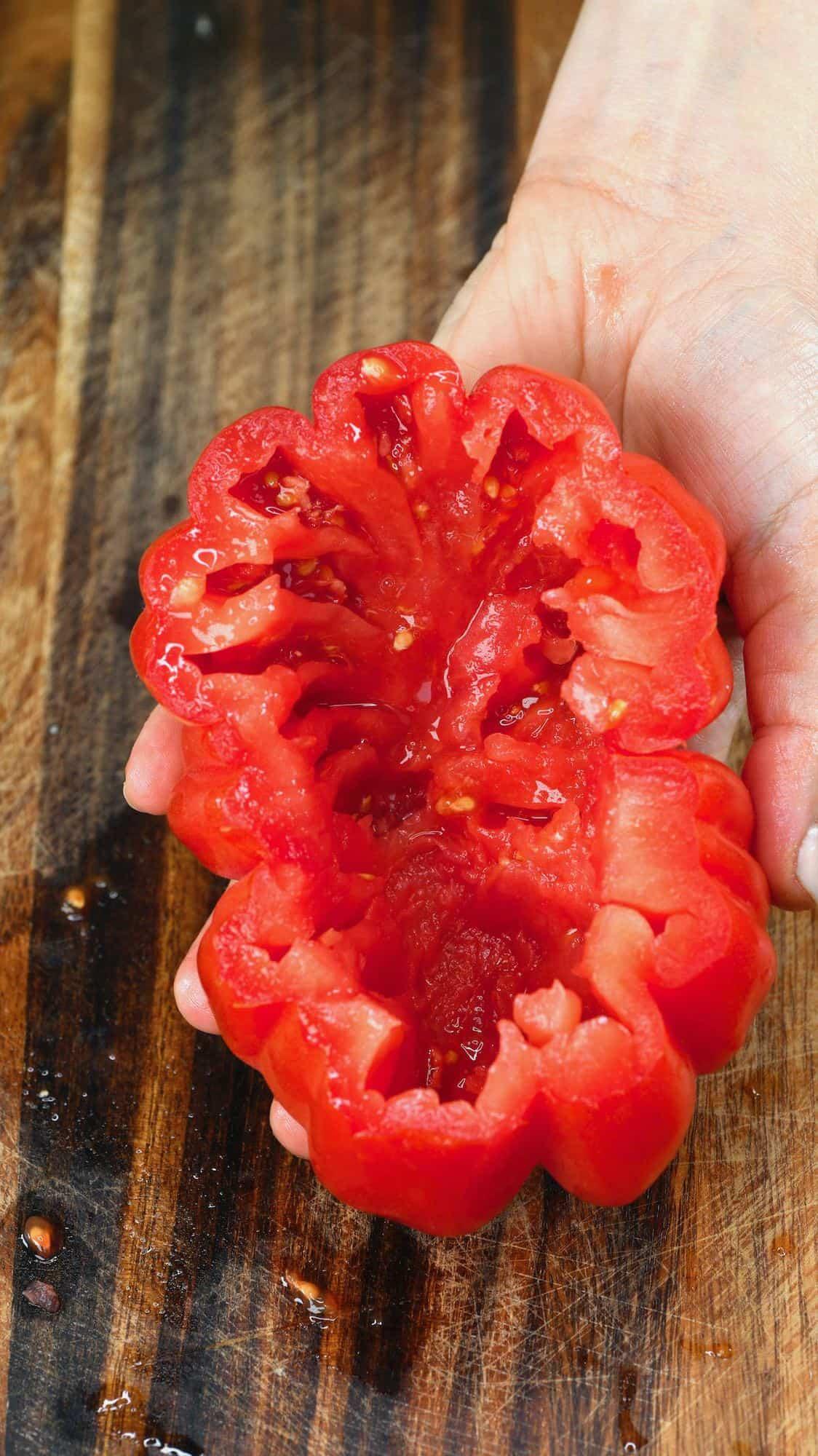 Holding a cored tomato
