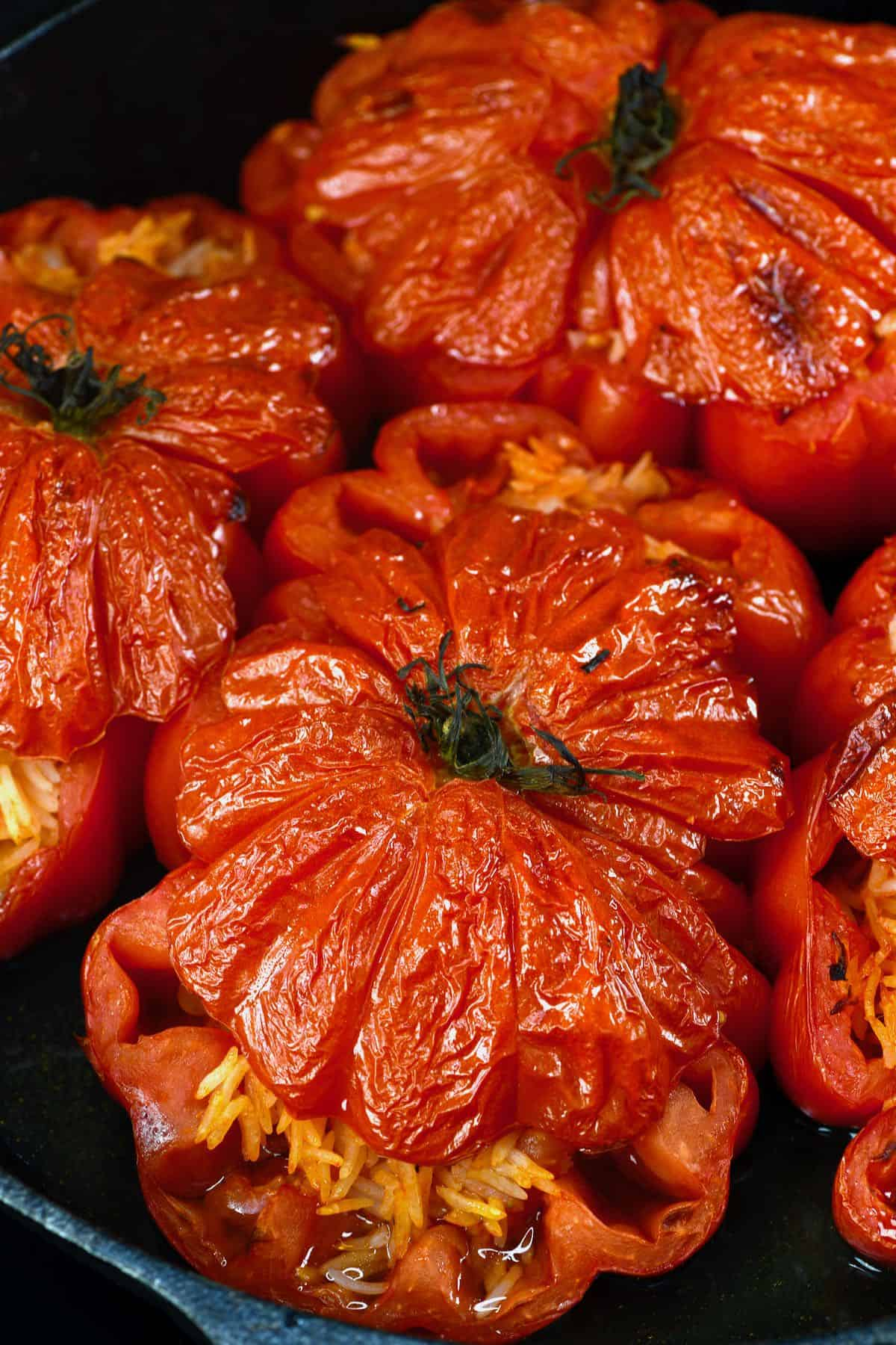 Stuffed tomatoes cooked in a pan