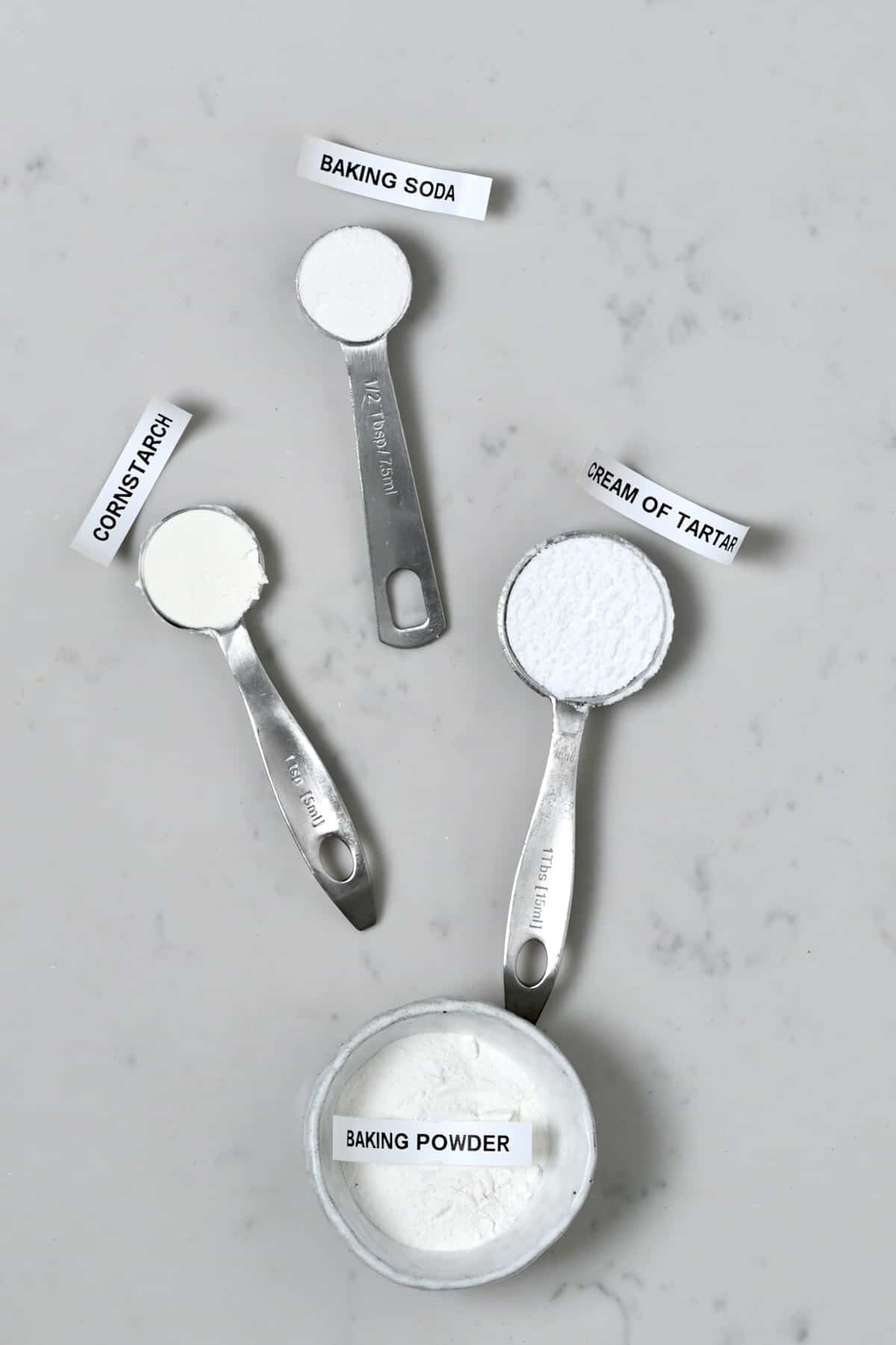 Measuring spoons with baking soda and cream of tartar