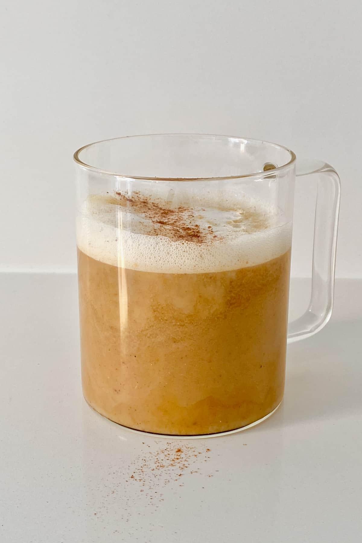 A glass of hot pumpkin spice latte